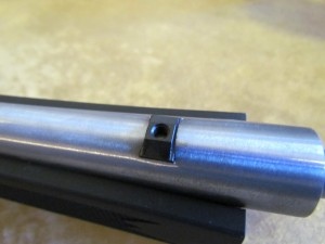 The dovetail mount fits loosely, so it should be installed last and the mounting screw not torqued until the rail is perfectly centered over the barrel.